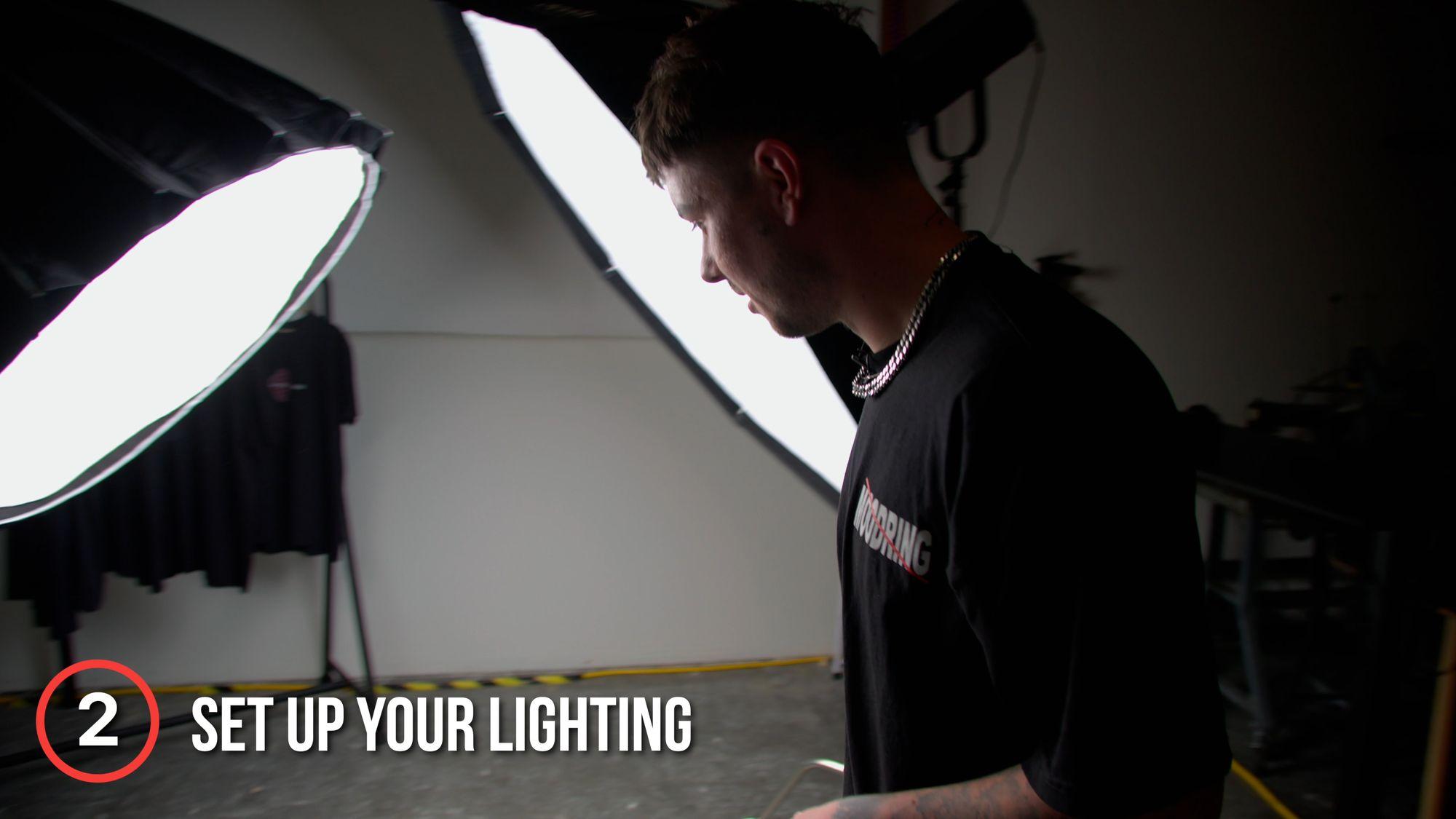 Image of Ieuan Thomas setting up lighting for a flat lay photo shoot